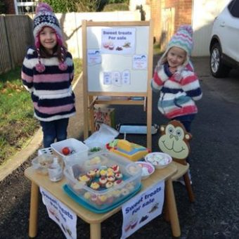 Annabel and Jessica fundraising with their Cake stand