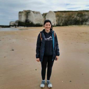 Jenny on beach in CLAPA hoodie