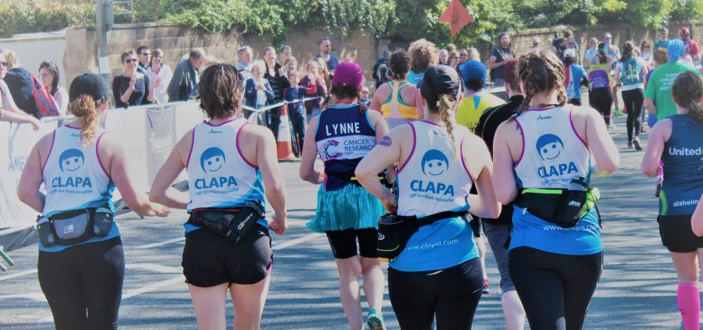 Four runners in CLAPA vests